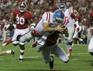 Mississippi quarterback Chad Kelly dives in for a touchdown against Alabama linebacker Shaun Hamilton during first half of an NCAA college football game, Saturday, Sept. 19, 2015, in Tuscaloosa, Ala. (AP Photo/Butch Dill)