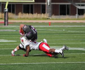 Defensive Back David Moore makes the tackle on a Northern Illinois ball carrier