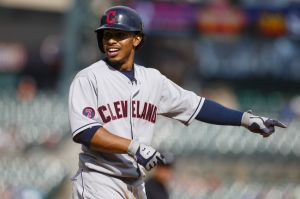 Jun 14, 2015; Detroit, MI, USA; Cleveland Indians designated hitter Francisco Lindor (12) reacts to tripping over first base after he hits a single in the ninth inning against the Detroit Tigers at Comerica Park. Mandatory Credit: Rick Osentoski-USA TODAY Sports