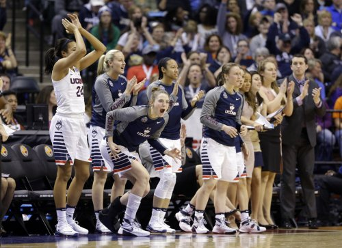 Connecticut's Katie Lou Samuelson, second from left, joins the bench to cheer during the second half of a national semifinal game against Oregon State, at the women's Final Four in the NCAA college basketball tournament Sunday, April 3, 2016, in Indianapolis. (AP Photo/Michael Conroy)